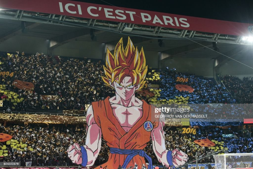 Paris Saint-Germain's supporters hold a tifo representing a character of Japanese manga Dragon ball as the words 'Here it's Paris' is seen above prior to the French L1 football match between Paris Saint-Germain (PSG) and Marseille (OM) at the Parc des Princes in Paris on February 25, 2018. /
