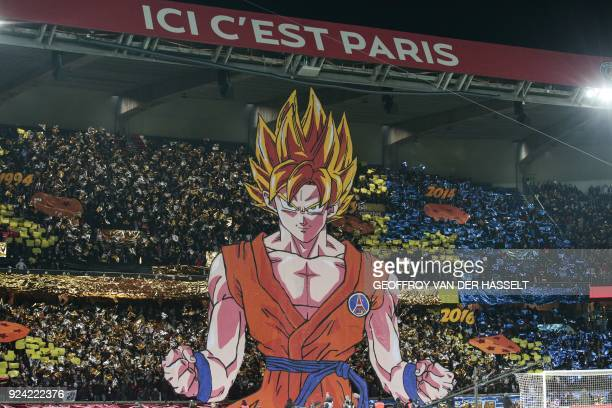 Paris SaintGermain's supporters hold a tifo representing a character of Japanese manga Dragon ball as the words 'Here it's Paris' is seen above prior...