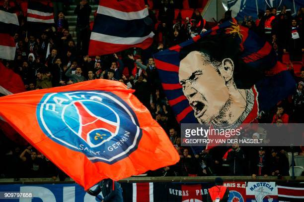 Paris SaintGermain's supporters wave flags during the French Cup round of 16 football match between Paris SaintGermain and Guingamp at the Parc des...