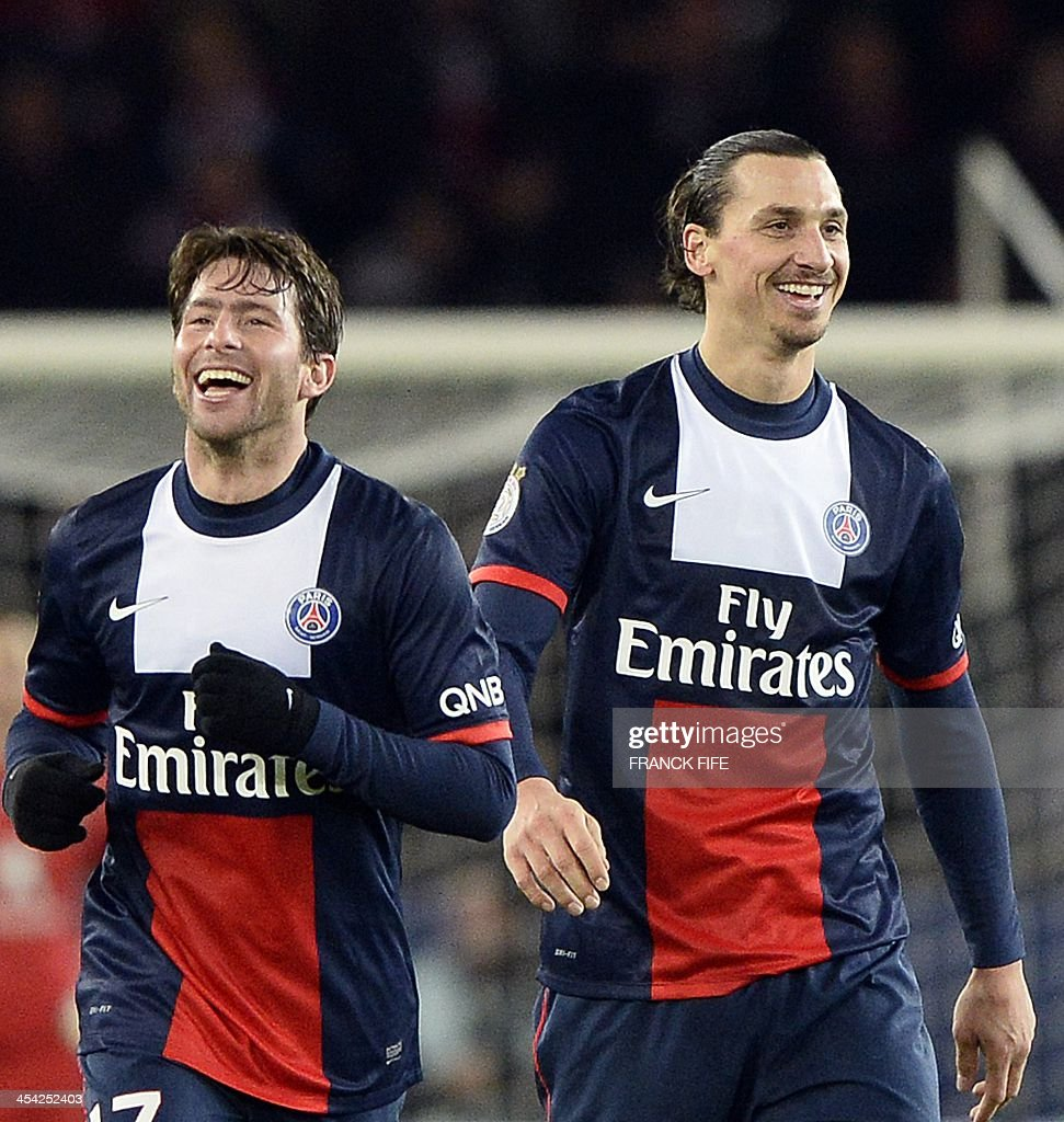 Paris Saint-Germain's Swedish forward Zlatan Ibrahimovic (R) and Brazilian defender Maxwell smile after a goal during the French L1 football match Paris Saint-Germain (PSG) vs Sochaux on December 7, 2013 at the Parc des Princes stadium in Paris. Paris won 5-0.