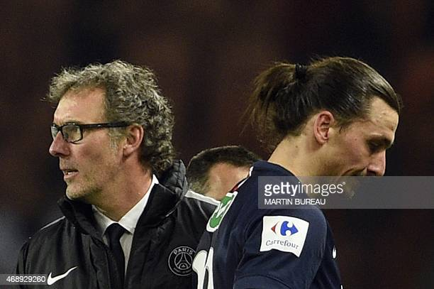Paris SaintGermain's Swedish forward Zlatan Ibrahimovic and Paris SaintGermain head coach Laurent Blanc leave the pitch on April 8 2015 after a...