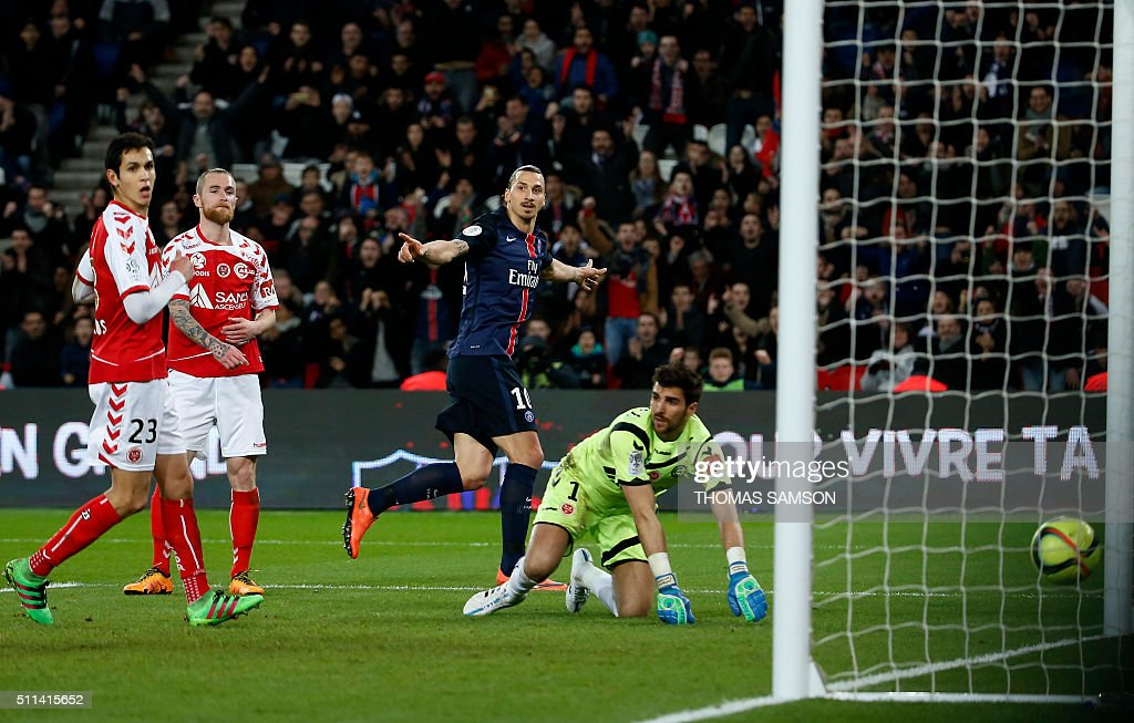 Paris Saint-Germain's Swedish forward Zlatan Ibrahimovic (C) celebrates after scoring a goal during the French L1 football match between Paris Saint-Germain (PSG) and Reims at the Parc des Princes stadium in Paris on February 20, 2016.
