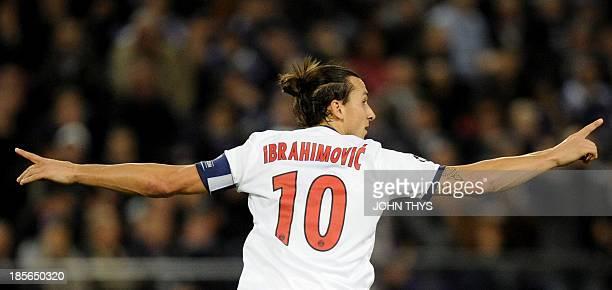Paris SaintGermain's Swedish forward Zlatan Ibrahimovic celebrates after scoring his team's third goal during the UEFA Champions League group C...