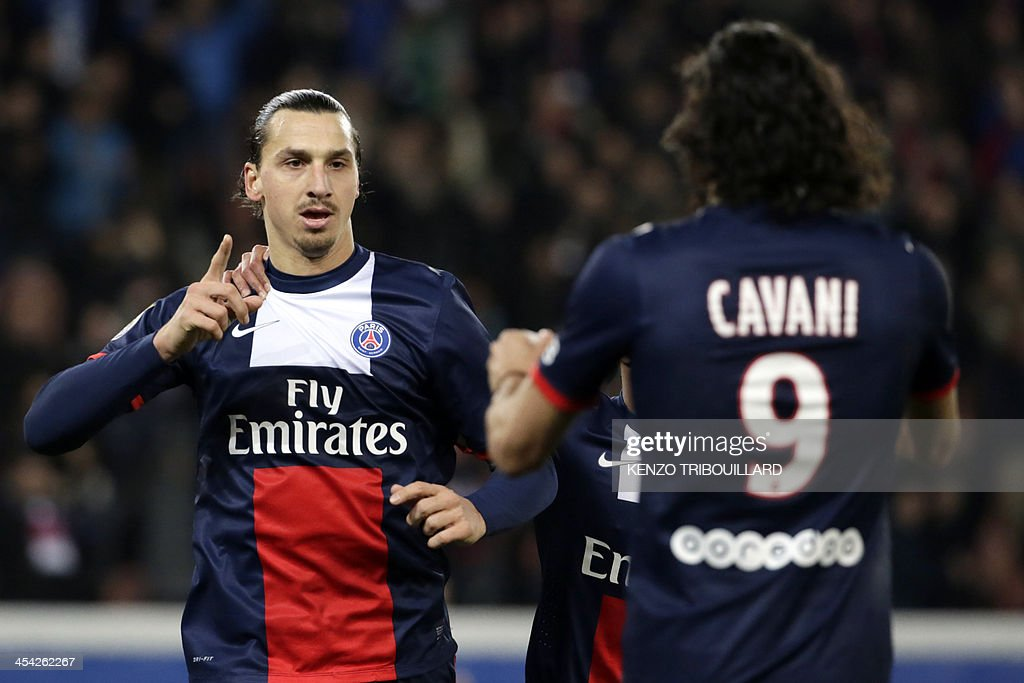 Paris Saint-Germain's Swedish forward Zlatan Ibrahimovic (L) celebrates with Uruguayan forward teammate Edinson Cavani after scoring a goal during the French L1 football match between Paris Saint-Germain and Sochaux at the Parc des Princes Stadium in Paris on December 7, 2013.