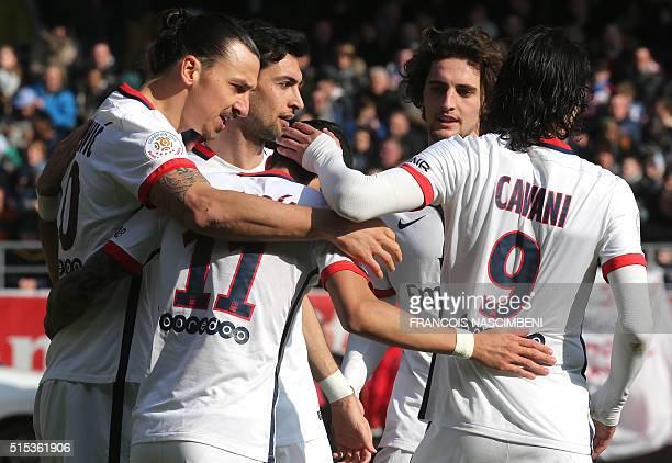 Paris SaintGermain's Swedish forward Zlatan Ibrahimovic celebrates with teammates Argentinian forward Angel Di Maria Argentinian midfielder Javier...