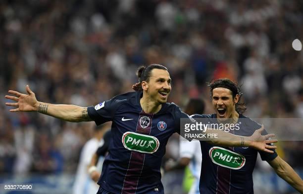 TOPSHOT Paris SaintGermain's Swedish forward Zlatan Ibrahimovic celebrates with Paris SaintGermain's Uruguayan forward Edinson Cavani after scoring a...