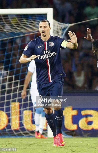 Paris SaintGermain's Swedish forward Zlatan Ibrahimovic is congratulated by a teammate after scoring a goal during the friendly football match...