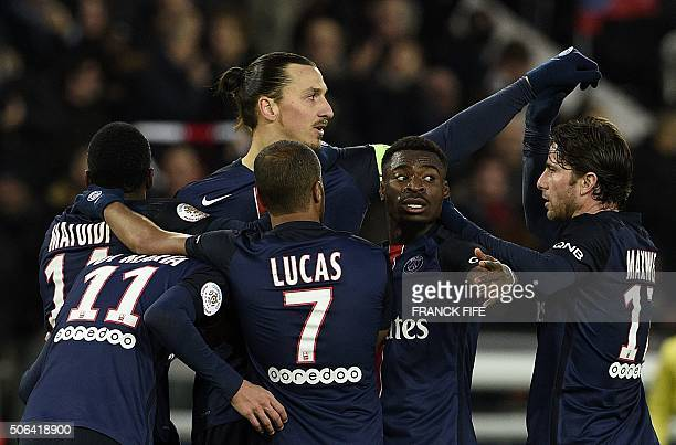 TOPSHOT Paris SaintGermain's Swedish forward Zlatan Ibrahimovic is congratulated by teammates after scoring a goal during the French L1 football...