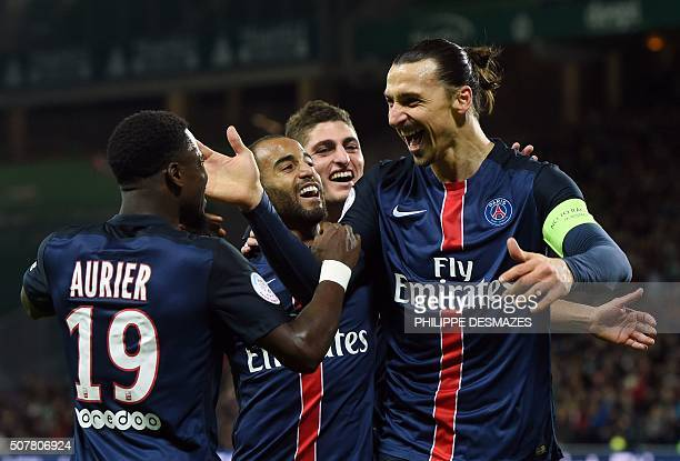 TOPSHOT Paris SaintGermain's Swedish forward Zlatan Ibrahimovic R celebrates with Paris SaintGermain's French midfielder Serge Airier Paris...