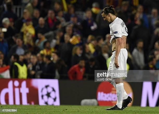 Paris Saint-Germain's Swedish forward Zlatan Ibrahimovic reacts at the end of the UEFA Champions League quarter-finals second leg football match FC...