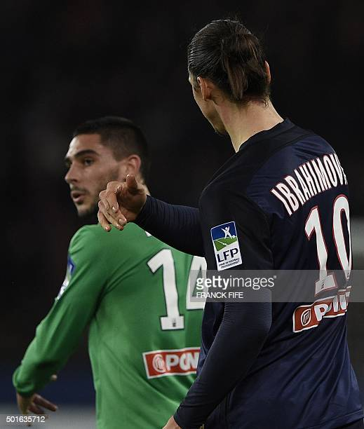 Paris SaintGermain's Swedish forward Zlatan Ibrahimovic reacts next to SaintEtienne's French forward Neal Maupay during the French League Cup...