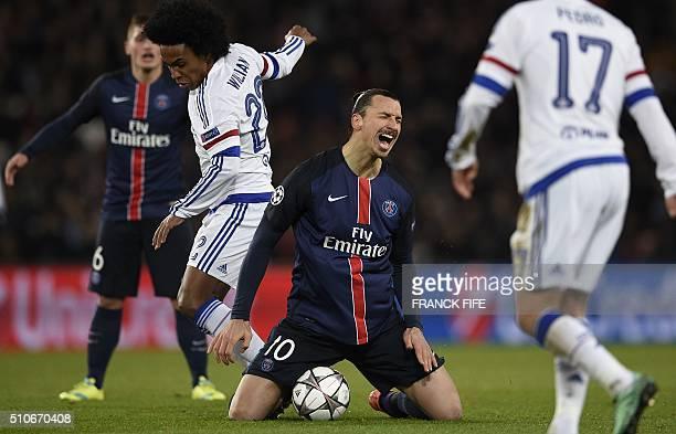 Paris SaintGermain's Swedish forward Zlatan Ibrahimovic reacts next to Chelsea's Brazilian midfielder Willian during the Champions League round of 16...