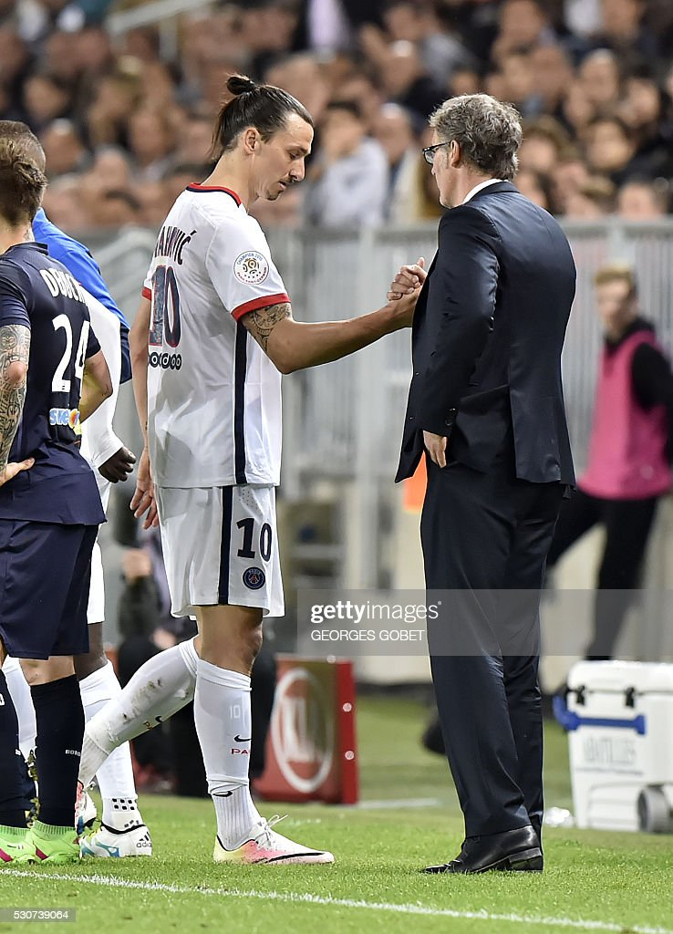 Paris Saint-Germain's Swedish forward Zlatan Ibrahimovic shakes hands with Paris Saint-Germain's French head coach Laurent Blanc as he leaves the pitch during the French L1 football match between Bordeaux and Paris (PSG) on May 11, 2016 at the Matmut Atlantique stadium in Bordeaux, southwestern France.