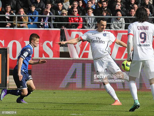 Paris SaintGermain's Swedish forward Zlatan Ibrahimovic shoots and scores a goal despite Troyes' French midfielder Alois Confais during the French...