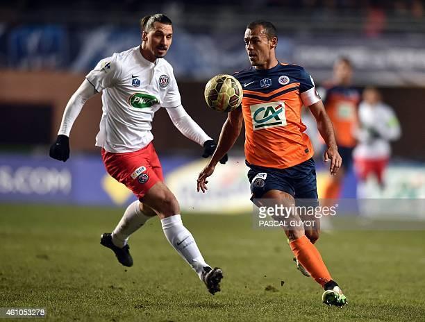 Paris Saint-Germain's Swedish forward Zlatan Ibrahimovic vies with Montpellier's Brazilian defender Vitorino Hilton during the French Cup football...