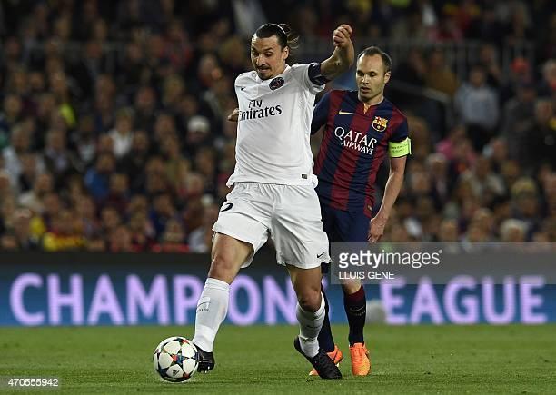 Paris Saint-Germain's Swedish forward Zlatan Ibrahimovic vies with Barcelona's midfielder Andres Iniesta during the UEFA Champions League...