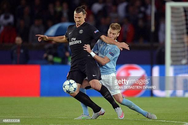 Paris SaintGermain's Swedish forward Zlatan Ibrahimovic vies with Malmo's Swedish defender Rasmus Bengtsson during the UEFA Champions League group A...