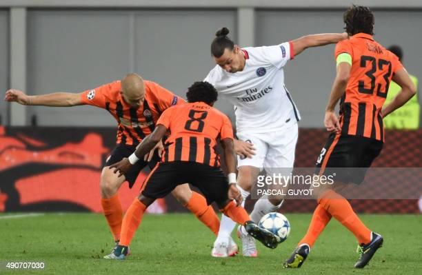 Paris SaintGermain's Swedish forward Zlatan Ibrahimovic vies with Shakhtar Donetsk's Brazilian midfielder Fred and Shakhtar Donetsk's Croatian...