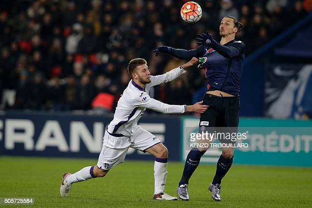 Paris SaintGermain's Swedish forward Zlatan Ibrahimovic vies with Toulouse's French midfielder Alexis Blin during the French Cup football match Paris...