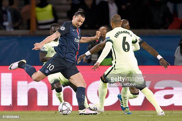Paris SaintGermain's Swedish forward Zlatan Ibrahimovic vies with Manchester City's Brazilian midfielder Fernando during the UEFA Champions League...