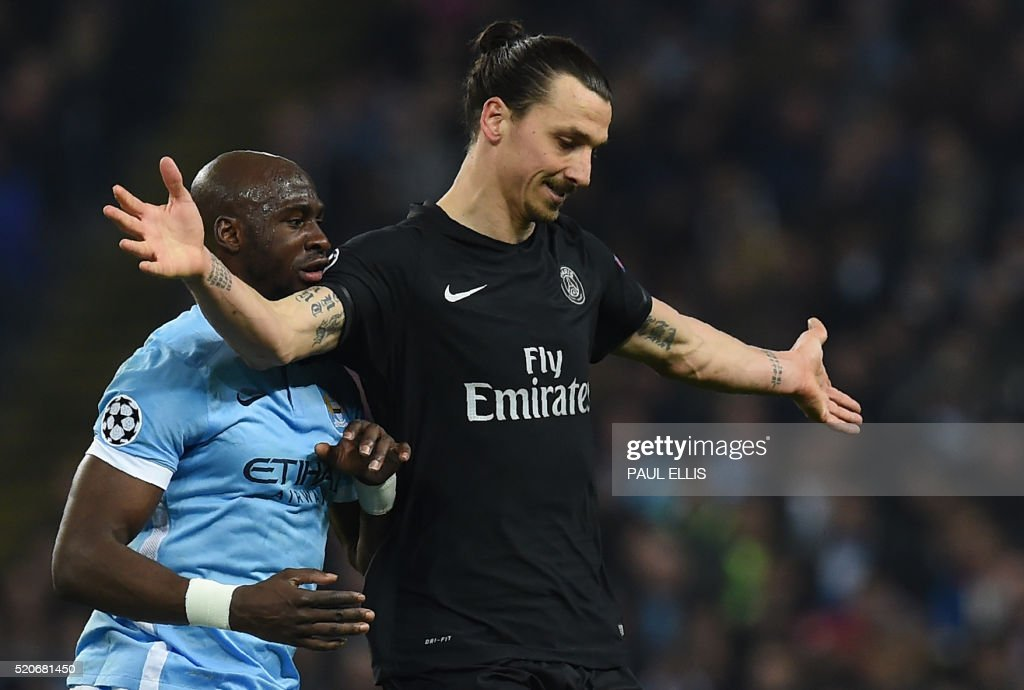 TOPSHOT - Paris Saint-Germain's Swedish forward Zlatan Ibrahimovic (R) vies with Manchester City's French defender Eliaquim Mangala during the UEFA Champions league quarter-final second leg football match between Manchester City and Paris Saint-Germain at the Etihad stadium in Manchester on April 12, 2016. /