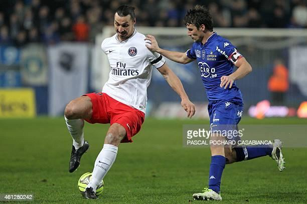 Paris SaintGermain's Swedish midfielder Zlatan Ibrahimovic challenges Bastia's French midfielder Yannick Cahuzac during the French L1 football match...