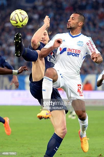 Paris SaintGermain's Swedish midfielder Zlatan Ibrahimovic vies for the ball with Marseille's Togolese midfielder JacquesAlaixys Romao during the...