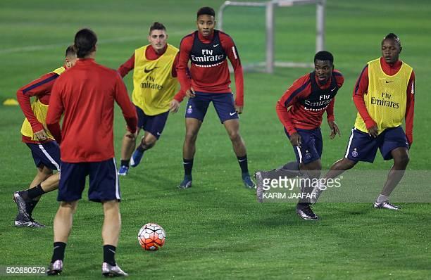 Paris SaintGermain's Swedish striker Zlatan Ibrahomovic prepares to pass the ball as French forward Herve Ongenda Ivory Coast defender Serge Aurier...