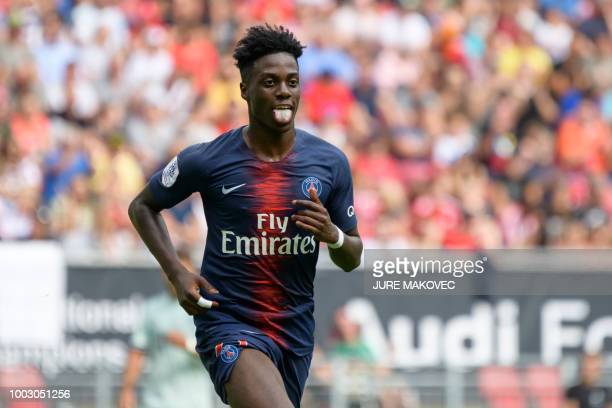 Paris SaintGermain's Timothy Weah celebrates after scoring a goal during their International Champions Cup football match Bayern Munich against Paris...