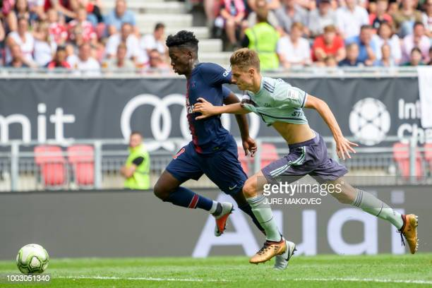 Paris SaintGermain's Timothy Weah vies for the ball with Bayern Munich's Josip Stanisic during their International Champions Cup football match...