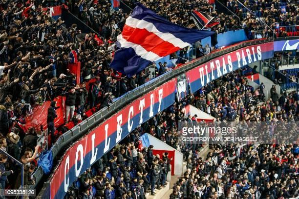 Paris Saint-Germain's ultra-fanatical fans, known as Ultras, are seen in the Virage Auteil tribune inside the Parc des princes stadium in Paris on...