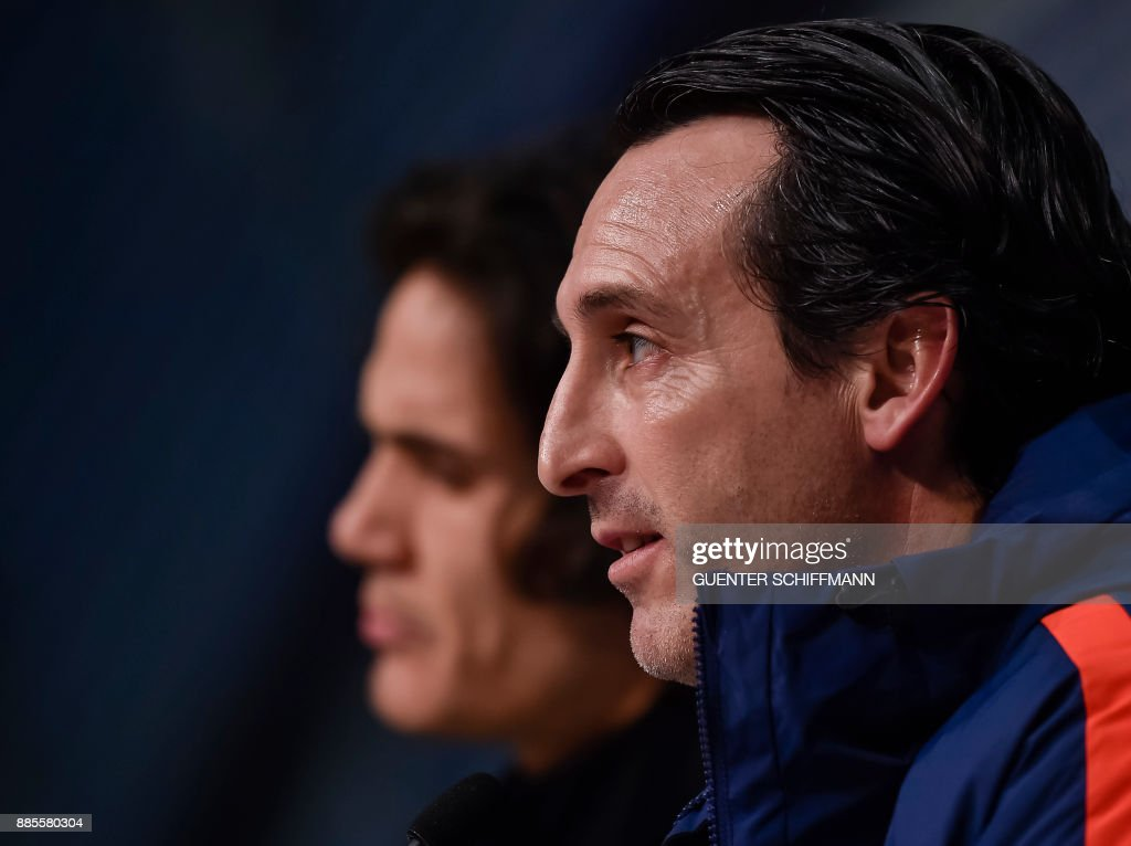 Paris Saint-Germain's Uruguaian striker Edinson Cavani (L) and Paris Saint-Germain's Spanish head coach Unai Emery hold a joint press conference of Paris Saint-Germain ahead of the UEFA Champions League Group B match between FC Bayern Munich vs PSG Paris, at the Allianz Arena in Munich, southern Germany, on December 4, 2017. /
