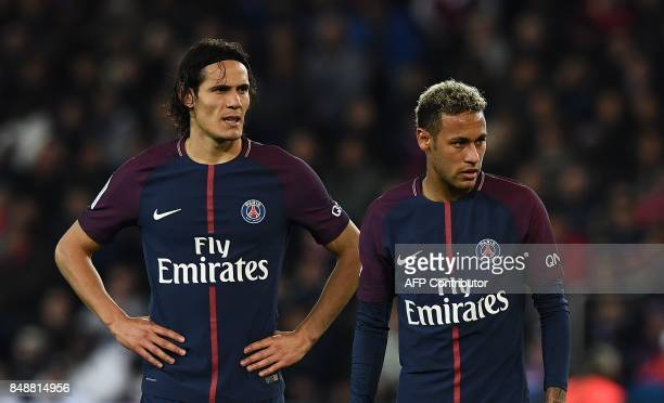 TOPSHOT Paris SaintGermain's Uruguayan forward Edinson Cavani and Paris SaintGermain's Brazilian forward Neymar react during the French Ligue 1...