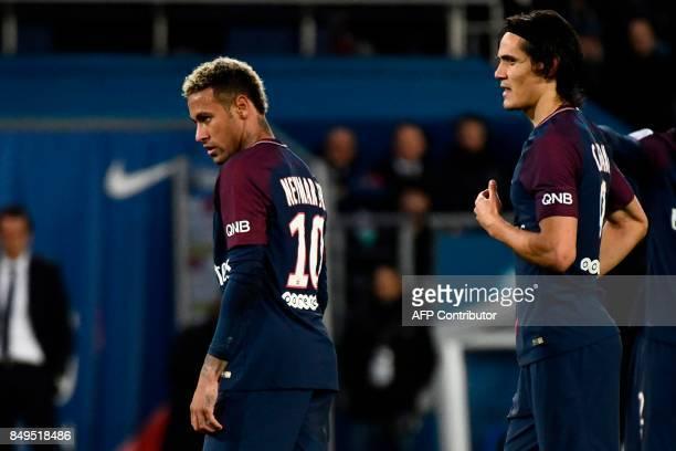 Paris SaintGermain's Uruguayan forward Edinson Cavani and Paris SaintGermain's Brazilian forward Neymar react during the French Ligue 1 football...