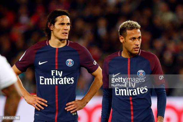 Paris SaintGermain's Uruguayan forward Edinson Cavani and Paris SaintGermain's Brazilian forward Neymar react during the French Ligue 1 football...