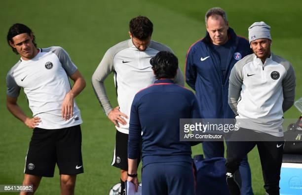 Paris SaintGermain's Uruguayan forward Edinson Cavani and Paris SaintGermain's Brazilian forward Neymar listen to Paris SaintGermain's Spanish head...