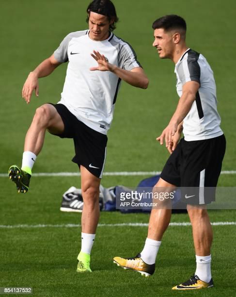 Paris SaintGermain's Uruguayan forward Edinson Cavani and Paris SaintGermain's Spanish defender Yuri Berchiche stretch during a training session on...