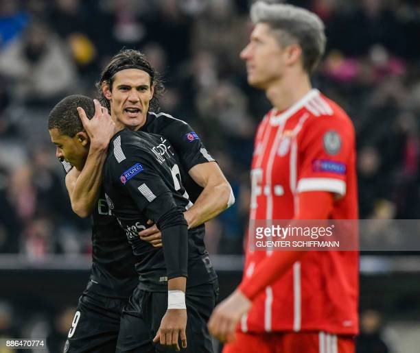 Paris SaintGermain's Uruguayan forward Edinson Cavani and Paris SaintGermain's French striker Kylian Mbappe celebrate the first goal for their team...