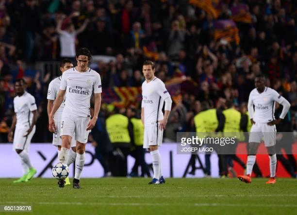 Paris SaintGermain's Uruguayan forward Edinson Cavani and teammates stand on the pitch after Barcelona's Brazilian forward Neymar scored his team's...