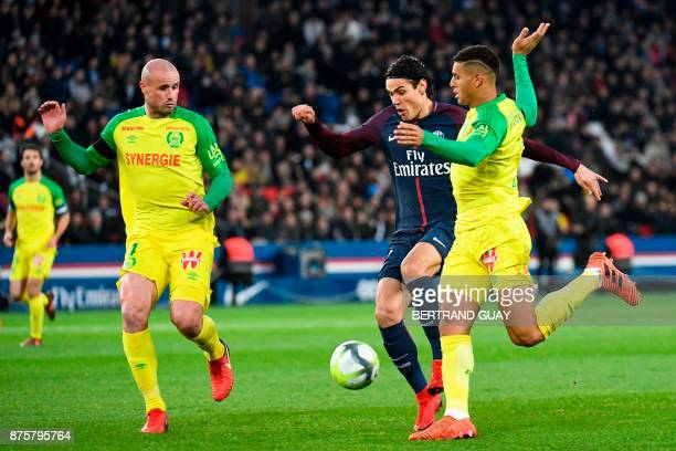 Paris SaintGermain's Uruguayan forward Edinson Cavani attempts to shoot on goal between Nantes' Brazilian defender Diego Carlos and Nantes' French...