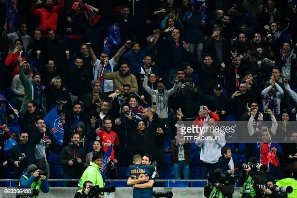 TOPSHOT Paris SaintGermain's Uruguayan forward Edinson Cavani celebrate with Paris SaintGermain's French defender Layvin Kurzawa after scoring a goal...