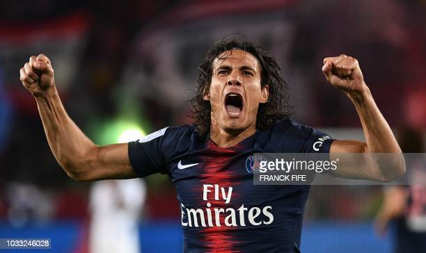 Paris Saint-Germain's Uruguayan forward Edinson Cavani celebrates after scoring a penalty kick during the French L1 football match between Paris...