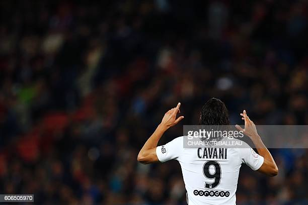 Paris SaintGermain's Uruguayan forward Edinson Cavani celebrates after scoring a goal during the French L1 football match between Caen and Paris...