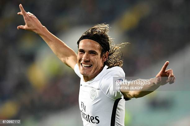TOPSHOT Paris SaintGermain's Uruguayan forward Edinson Cavani celebrates after scoring during the UEFA Champions League Group A football match...