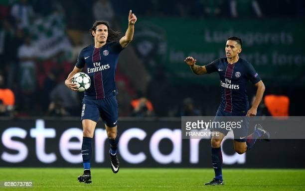 Paris SaintGermain's Uruguayan forward Edinson Cavani celebrates after scoring a goal with Paris SaintGermain's Brazilian defender Marquinhos during...