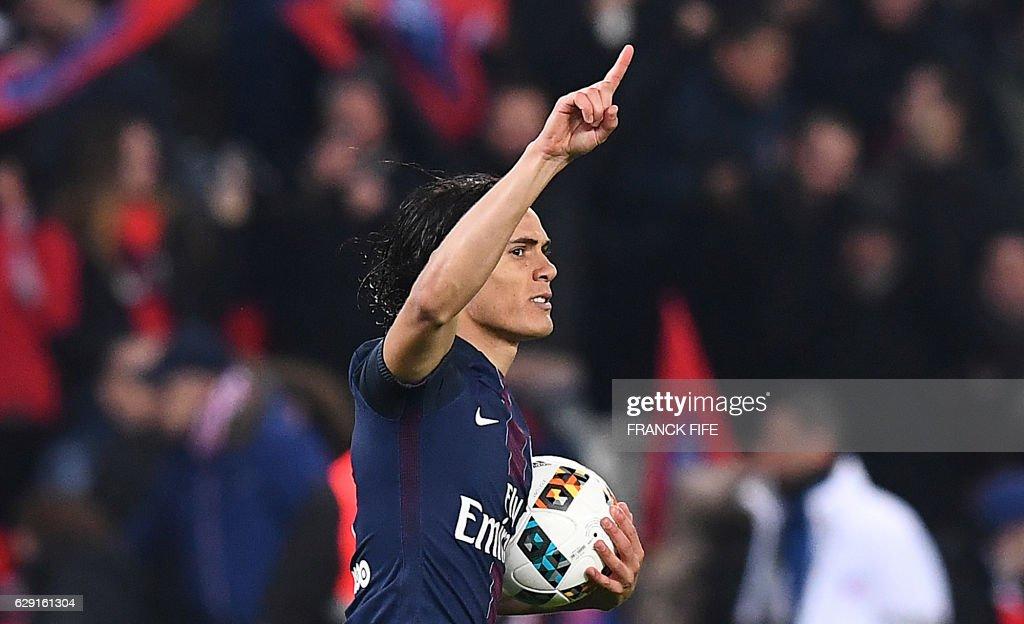 Paris Saint-Germain's Uruguayan forward Edinson Cavani celebrates after scoring a goal during the French L1 football match between Paris Saint-Germain and Nice at the Parc des Princes stadium in Paris on Deecmber 11, 2016. /