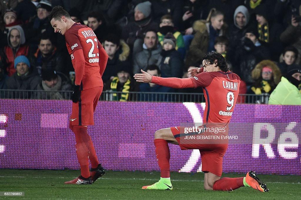 Paris Saint-Germain's Uruguayan forward Edinson Cavani celebrates after scoring a goal during the French L1 football match between Nantes and Paris Saint-Germain on January 21, 2017 at the Beaujoire stadium of Nantes, western France. / AFP / JEAN