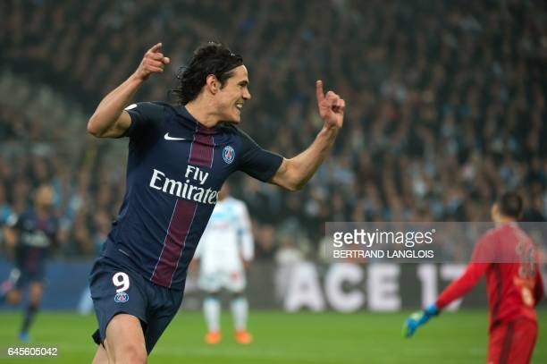 Paris Saint-Germain's Uruguayan forward Edinson Cavani celebrates after scoring a goal during the French L1 football match Olympique de Marseille vs...
