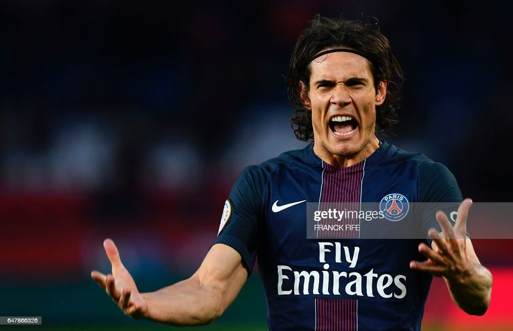 Paris Saint-Germain's Uruguayan forward Edinson Cavani celebrates after scoring a goal during the French L1 football match between Paris Saint-Germain (PSG) and Nancy (ASNL) at the Parc des Princes stadium in Paris on March 4, 2017. /