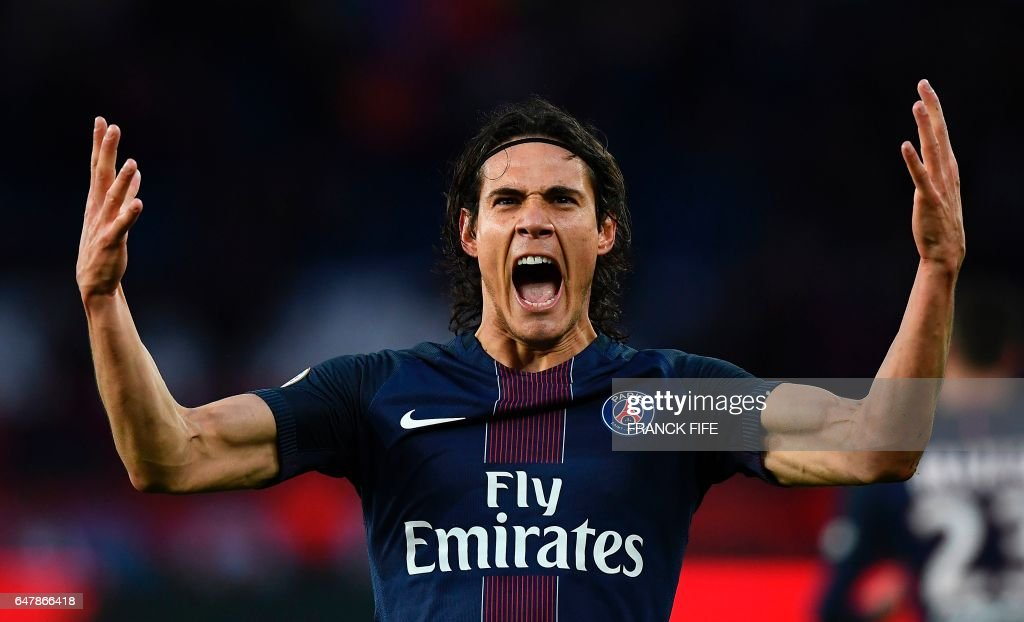 TOPSHOT - Paris Saint-Germain's Uruguayan forward Edinson Cavani celebrates after scoring a goal during the French L1 football match between Paris Saint-Germain (PSG) and Nancy (ASNL) at the Parc des Princes stadium in Paris on March 4, 2017. /